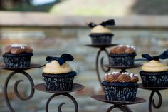us a large candelabra for cupcakes at a dessert bar, wedding dessert bar, party dessert bar. for easy decorations, add a bow on the cupcakes