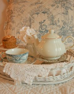 A cup of tea makes everything seem better. tea. teacup. muffin. tea tray.