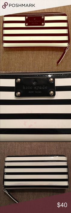 Authentic Kate Spade striped black & white wallet Pre- owned still in good condition. Has some wear and slight coloration on front and back as seen in photos.. great size wallet fits a lot. kate spade Bags Wallets