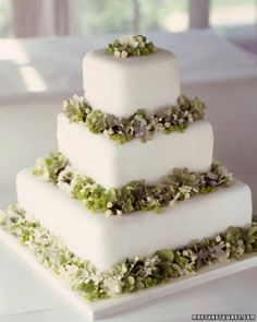 This fondant-covered cake decorated with hydrangeas is made of three graduated square tiers.