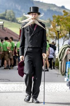 A contestant of the World Beard And Mustache Championships walks during the opening ceremony of the Championships 2015 on October 3, 2015 in Leogang, Austria.