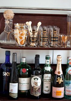 I want to create a bar like this... love the glasses & skull stirrers.