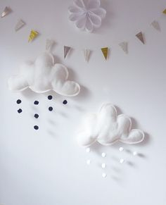 love the cloud mobiles and bunting from le petit papillon