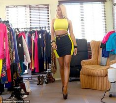No shrinking violets allowed: Nicki Minaj left little to the imagination in a skintight two-piece while shooting a commercial for her Kmart clothing line on Wednesday