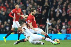 Watford's English mifielder Tom Cleverley tackles Manchester United's Dutch midfielder Daley Blind during the English Premier League football match...