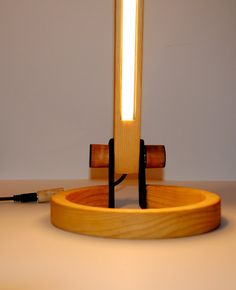 Desk lamp, made of pinewood. You can select where you want to highlight, by rotating the light source. Comes with cable dimmer and works with 12V power supply (Included). Dimensions: Height 63cm, Base diameter 16cm.