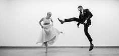 This picture looks very fun. The couples look like they are having a lot of fun dancing together. The photographer very much caught the mood and the excitement of the two couples in the photo. It is a pretty cool thing to be able to see the happiness and excitement of two people who are enjoying life. I also like the black & white aspect of the photo, it add more to the photos features.