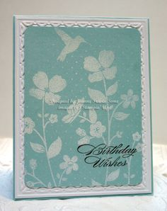 Soft Sky Meadow-inked the new Wildflower Meadow stamp in craft white and then stamped the Birthday Wishes sentiment (Bring on the Cake) in Soft Suede. While white ink was still wet, I added white embossing powder to image, brushing it off over the sentiment with a small paint brush before heat embossing. Added panel to a Whisper White and Soft Sky base, also used Framed Tulips embossing folder.