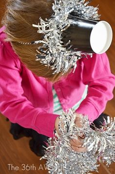 New Year's Eve Party Hat All you need is paper cups, tinsel garland, some ribbon, elastic, or twine.