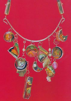 William Harper A BIB OF CHARMS II 1980 gold and silver cloisonne'enamel on copper; 14 and 24 kt gold; sterling silver; moonstone