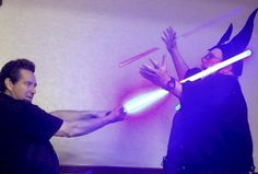 """At the 2014 Tucson Science Fiction Convention, Geoff Noktin giving his new light saber a test run. It is (in Darth Vader voice) """"Impressive."""""""
