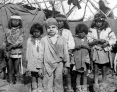 The captive white boy, Santiago McKinn, poses with a group of children in Geronimo's Camp. The photo by Camillus Sidney Fly was taken in 1886 shortly before Geronimo's surrender to General George Crook on March 27, 1886. McKinn was taken from his home near Mimbres in the New Mexico Territory in 1885 by Chiricahua Apaches. McKinn assimilated with the Apaches during his captivity — even learning their language — and cried when he was returned to his family.