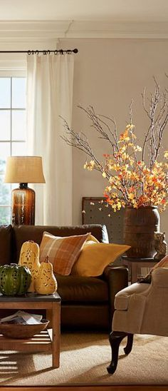 A few accents and plaid throw pillows instantly add an autumn inspired theme.