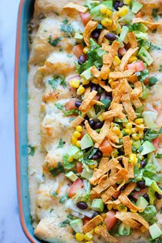 White Chicken Enchiladas with Green Chile Sour Cream Sauce - Theseenchiladas have the easiest cream sauce you could ever make!