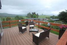 Reliaboard Cedar Decking blends well with the wooden handrail in this idyllic Timbertech Decking, Composite Decking, Outdoor Furniture Sets, Outdoor Decor, Wood Grain, Home Decor, Decoration Home, Composite Cladding, Room Decor