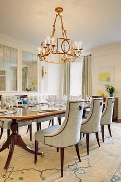 Sophisticated Antique Chandeliers And Cozy Chairs In Traditional Dining Room With Long Wooden Table On Brown Carpet