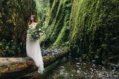 Organic riverbed elopement inspiration shoot in Oneonta Gorge of Oregon // photo by Jess Hunter // dress by BHLDN // florals by Ponderosa and Thyme // Portland wedding photographer // Oregon bride // columbia river gorge, oregon elopement // alaska wedding photographer // nature-inspired intimate wedding // portland, oregon wedding // intimate forest wedding // wedding in the woods // pacific northwest elopement location // artistic and organic wedding photography