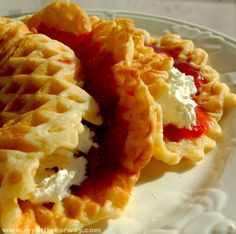 Norwegian waffles (Vafler)--original recipe: 6 eggs 1/2 cup sugar 1 tsp. ground cardamom 1 1/2 cup flour 1 tsp. baking powder Pinch of salt 1 cup sour cream 1/2 cup melted butter 3 Tbsp. butter for frying Preparation Mix eggs, sugar, and cardamom together in a big bowl. Add in flour, baking powder, and salt. Mix these ingredients and beat in sour cream and butter until the batter is smooth. Let the batter sit for about 20 minutes before you being making the waffles. Heat up the iro...
