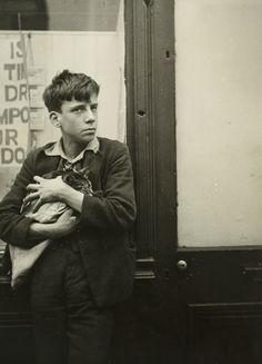 Garcon Avec Un Chat Dans Les Bras Appuye' Contre Une Vitrine (Boy with cat in arms leaning on window), 1934. Dora Maar. Ferrotype print.
