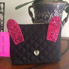 Just In  Betsey Johnson Disco Bunny Bag Black Cosmo Disco Bunny Cosmetic Bag from Betsey Johnson.  Black/ Fuchsia.  Super cute!!!! Betsey Johnson Bags Cosmetic Bags & Cases