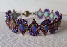 "Fun pattern called ""Dainty Delight"" by Andrea Mazzenga owner of Buttercup beads. 15/0 Toho 332 11/0 Miyuki 462 3mm F.B. purple iris silky green op. sliperit miniduo met. suede purple"