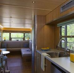 Ultra-Modern This ultra-modern home is actually a retired subway train car. Sleek stainless-steel interior accents pick up the exterior color, while birch paneling and flooring add to the airy feel of the home. Lots of windows and recessed lights make this train car bright and cheerful.