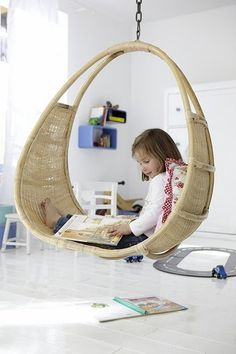 Rattan Hanging Chair ~ The sunroom of fashion designer Liz Lange's Westchester home is both chic and cheeky, thanks to a playful, swinging seat selected by designer Jonathan Adler. Description from pinterest.com. I searched for this on bing.com/images