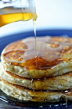 Lemon Poppyseed Pancakes Recipe - What a perfect way to start the day! They are full of bright lemon flavor and the beauty of poppy seeds! They are certainly a festive pancake for any morning! We love these! // addapinch.com