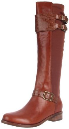 "Cole Haan Women's Tennley Buckle Knee-High Boot                                 Leather                    Leather and rubber sole                    Shaft measures approximately 17.25"" from arch                    Heel measures approximately 1""                    Boot opening measures approximately 13.5"" around                    Concealed Nike Air technology"