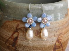Violet Earrings Tutorial by poetryinbeads using pip beads and pearls