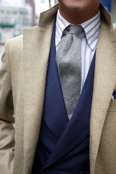 Love the size of the collar of the shirt, the color combination, the double breast jacket and the camel coat.