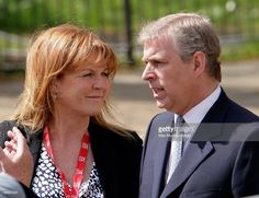 Sarah Ferguson, The Duchess of York talks with ex-husband HRH Prince Andrew, The Duke of York as they wait for daughter HRH Princess Beatrice of York to complete the Virgin London Marathon as part of the 'Caterpillar Run' Team, consisting of 32 runners tethered together on April 25, 2010 in London, England.