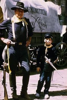 "John Wayne and his son, Ethan, on location for ""Rio Lobo,"" Cinema Center John Wayne Quotes, John Wayne Movies, Hollywood Stars, Old Hollywood, Iowa, Wayne Family, Actor John, Western Movies, Classic Movies"
