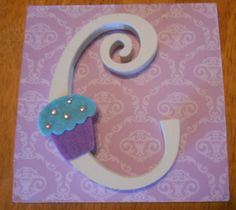 Purple Damask Plaque with Personal Initial & Purple Cupcake - Custom Made - Baby Nursery Decor / Toddler / Child Room - Boy or Girl. $8.99, via Etsy.