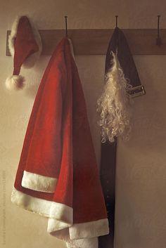 Closeup of Santa suit and beard on hook by Sandra Cunningham