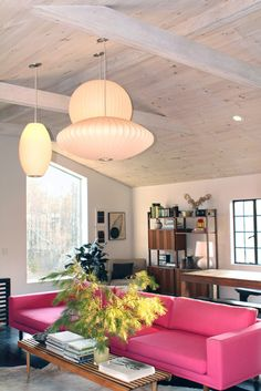 Totally....yes. Great elements. Love the hot pink sofa against the whitewashed wood. Hanging 3 different lights is brilliant.