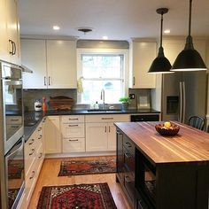 Completed kitchen! Took me an extra few days to get photos up. Oversized greige subway tile (bought for a steal!), handmade walnut butcher block island top, off white shaker cabinets. I hope we like it until we are 80!! #lesleyglotzl #interiordesign #rva
