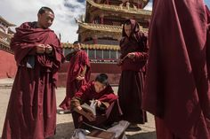 China Takes a Chain Saw to a Center of Tibetan Buddhism - The New York Times  Monks checking religious books for sale on the street. Larung Gar has also become one of the most influential centers in the Tibetan world. Credit Gilles Sabrié for The New York Times