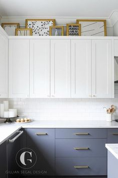White and gray kitchen design boasting brass hardware- small round brass knobs o. White and gray kitchen design boasting brass hardware- small round brass knobs on white shaker upper cabinets and long brass pulls on flat front lower gray cabinets. White Shaker Kitchen, Shaker Kitchen Cabinets, Gray Cabinets, White Kitchens, Above Cabinets, Kitchen Cabinet Knobs, Kitchen Flooring, Kitchen Furniture, Furniture Handles