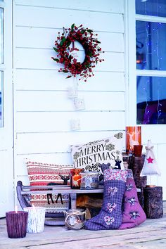 Christmas front door with red berry wreath and sleigh | The Relaxed Home