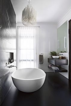 "A feature wall of Pietra Grigio marble tiles from [Bernini Stone & Tiles](http://www.bernini.com.au/?utm_campaign=supplier/|target=""_blank"") injects dark drama. Apaiser bath and basin, [Rogerseller](http://www.rogerseller.com.au/?utm_campaign=supplier/
