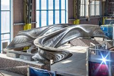 Dutch 3D printing company MX3D has recently finished production on the world's first fully 3D printed steel bridge. It has a unique design and advanced smart sensors, and should be installed over an Amsterdam canal sometime in the near future.