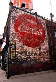 Stock Photo of  old coca cola advertising brick wall toronto canada coke