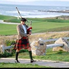 A man in a kilt playing bagpipes :)