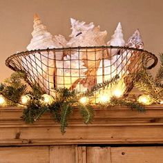 This is a creative way to display your beach finds and to include it in your coastal Christmas décor.