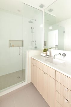 Shallow vanity with wall mounted faucet