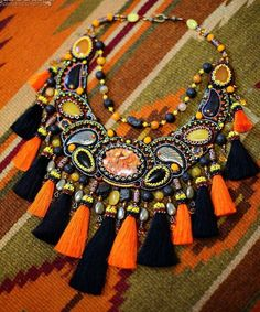 Nataly Uhrin is bead artist from Ukraine. She makes beautiful bright and colourful jewelry with