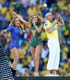 Pitbull Photos - (L-R) Singers Claudia Leitte, Jennifer Lopez and Pitbull perform during the Opening Ceremony of the 2014 FIFA World Cup Brazil prior to the Group A match between Brazil and Croatia at Arena de Sao Paulo on June 12, 2014 in Sao Paulo, Brazil. - Opening Ceremony of FIFA World Cup Brazil
