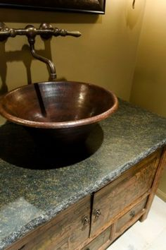 I'd love to put a new countertop on our bathroom sink and a mexican copper bowl sink on top. :)