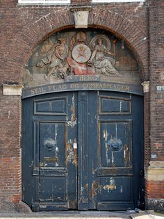 Door In Nyhavn In Copenhagen. The frieze at the top of the door with its carvings, harkens back to when this was a busy, working port.